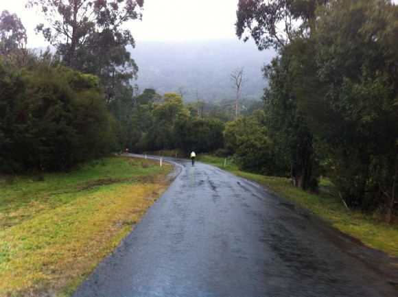 Climbing Don Road in the wet.