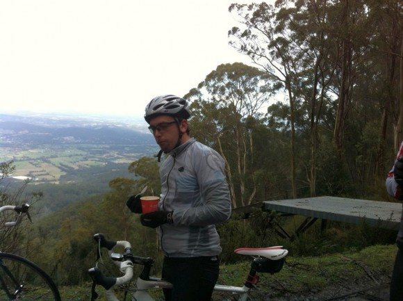 Brendan enjoying a cup of pumpkin soup with the Yarra Valley in the background.