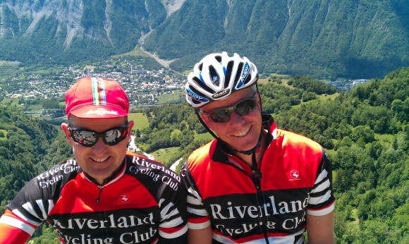 Angus (right) and his mate Steve Jaensch are all-smiles after climbing Alpe d'Huez.