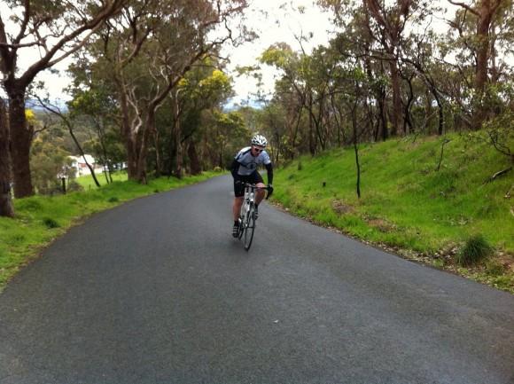 Brendan climbs Flat Rock Road.