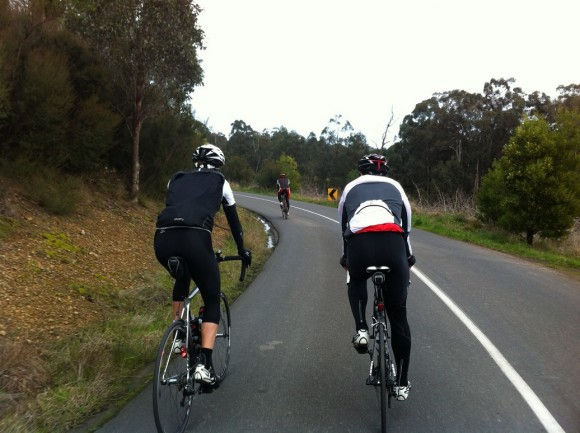 Dougie rides of the front with Evan (left) and Fletch in pursuit.
