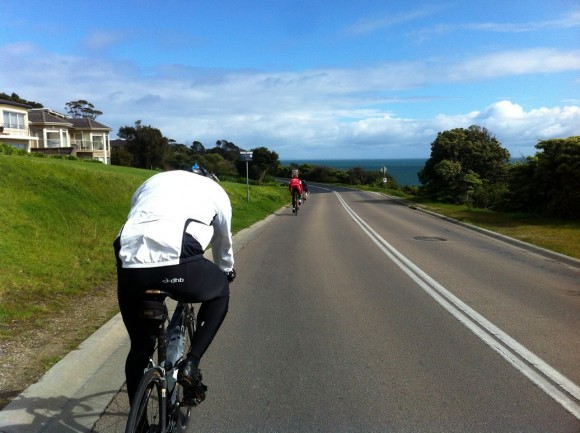Marcus (foreground) and Dougie (background) riding The Esplanade toward Safety Beach.