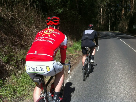 Dougie (red) and Fletch (black) climb toward Olinda.