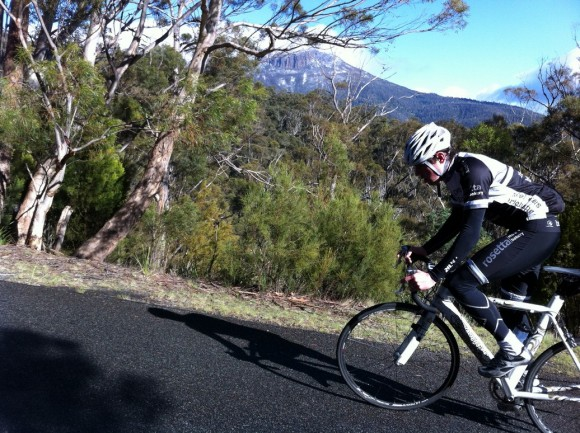 Dan taps away on the Waterworks climb with Mt. Wellington in the background.