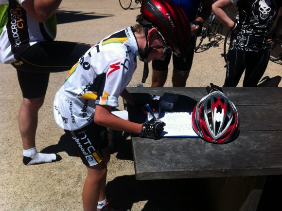 12-year-old Tristan Hocking-Brown signs in after finishing the climb.