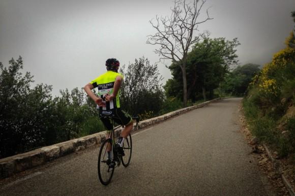 Climbing a foggy Col de la Madone.