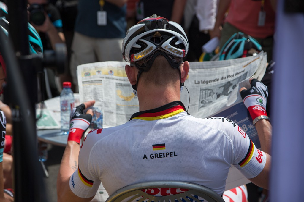 Greipel catches up on the day's news.