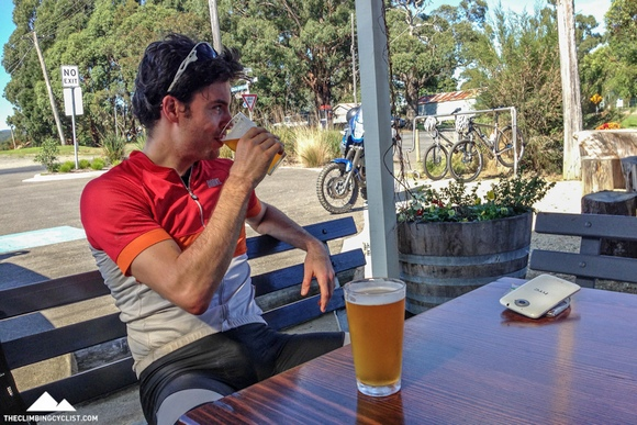 Nick enjoys a cold beverage  as we take a break between MTB sessions.