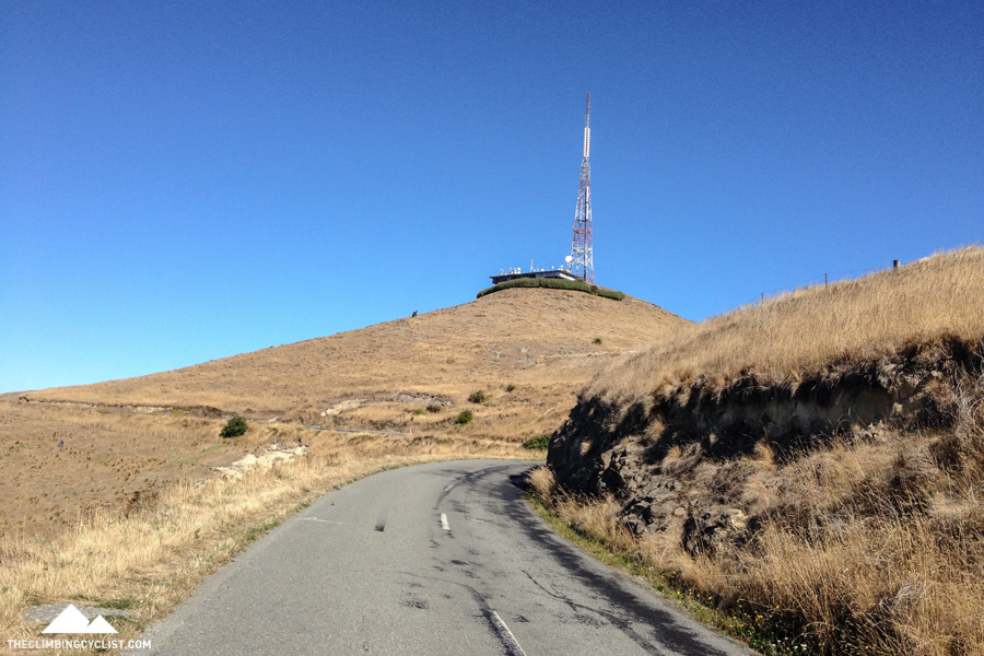 A communications tower on Summit Road. There's a narrow road that leads partway up that short hill ahead.