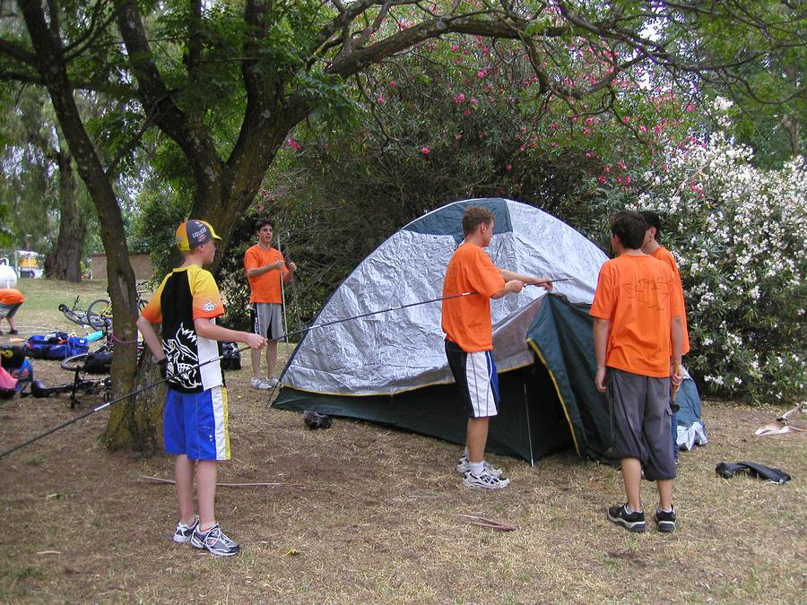 Setting up tents in Eldorado. That's me with the white shorts and orange shirt, holding the pole.